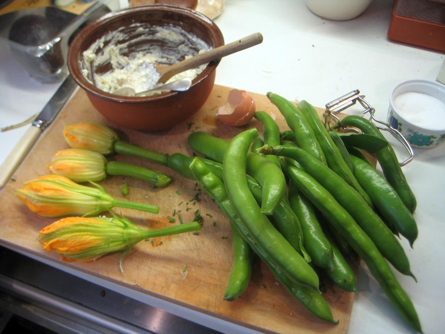 Broad beans and stuffed courgette flowers